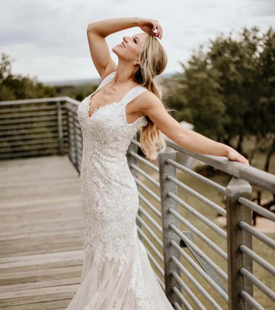 Model wearing a glitz & glam style white gown