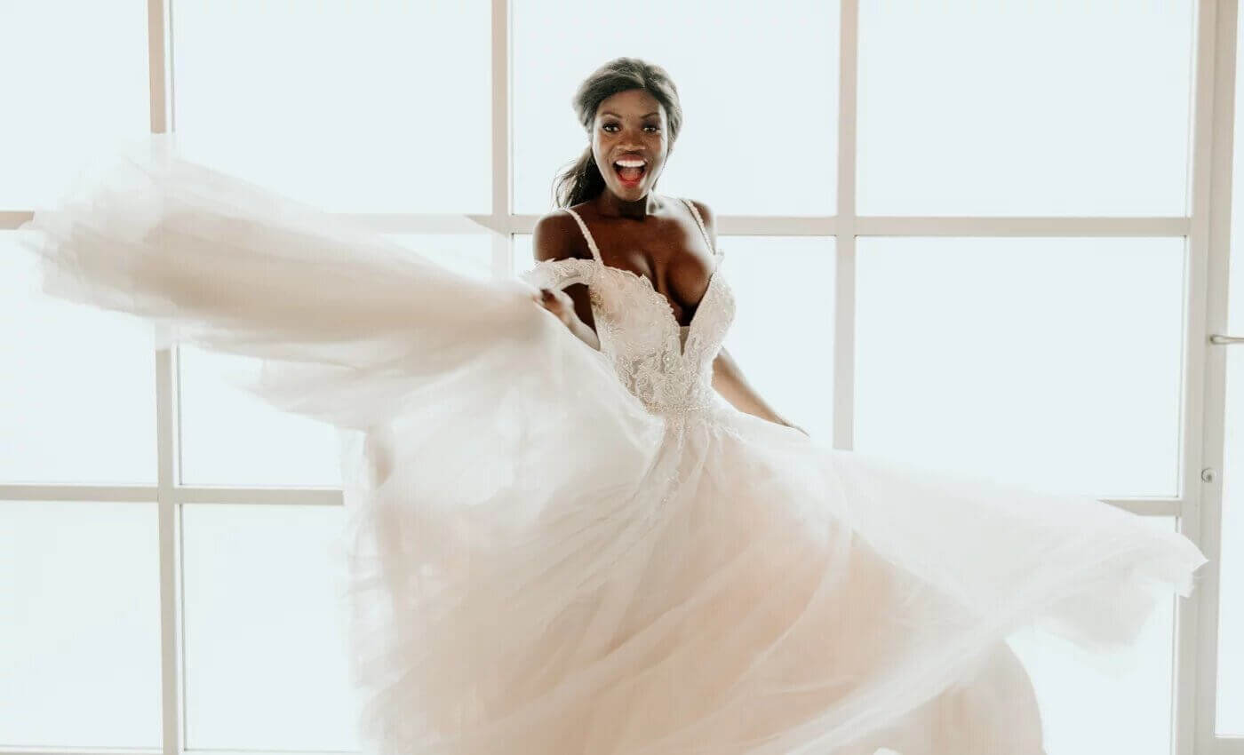 Photo of happy bride in a Bestow Bridal gown